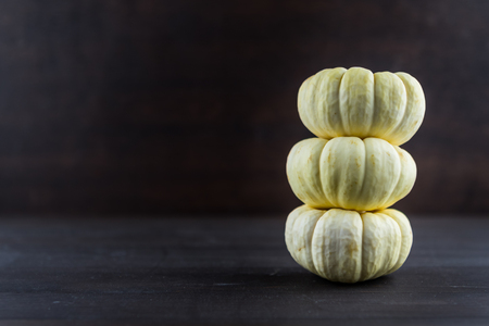 Three Baby Boo Pumpkins and Copy Space to left Stock Photo