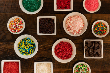Tight Shot of Array of Sprinkles over dark background Stock Photo
