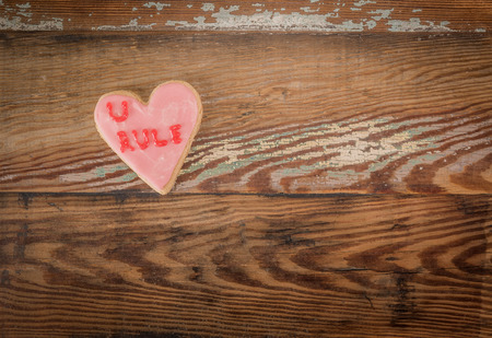 U Rule Heart Cookie with wooden backdrop