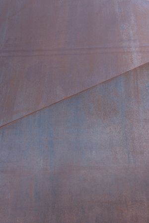 Rusted Steel Panel with Diagonal Seam vertical image
