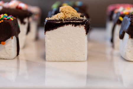 Low Angle View of Marshmallow S'more Cube on white marble
