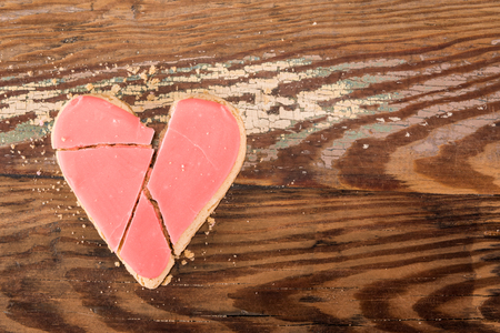 Broken Heart Cookie And Copy Space over wooden table Stock Photo