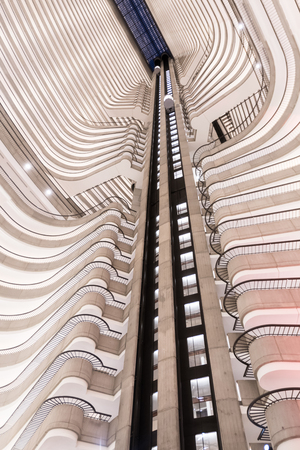March 3, 2018: Atlanta, United States: Balconies and Elevator Shaft in Atrium of modern hotel