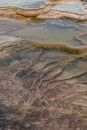 Water Rests in Gradual Stairs Formed by Hot Springs Erosion Stock Photo
