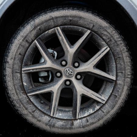 June 18, 2018: Conceptual Editorial of a Muddy Toyota Wheel
