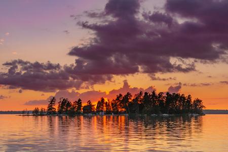 Orange Skies Behind Island and Lake in Minnesota