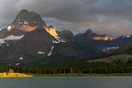 Mount Wilbur Behind lake on cloudy morning in summer