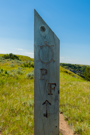 Petrified Forest Trail Marker points hikers toward the path Stock Photo
