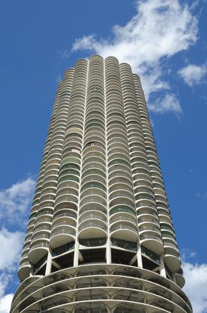 A unique round skyscraper with parking underneath housing unite