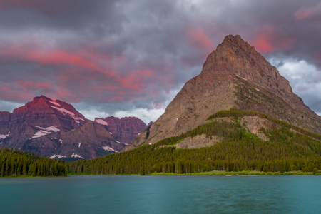 Pink Light Above Grinnell Point as sunrise breaks above the horizon