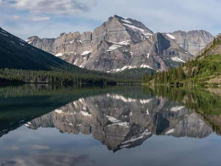 Mountains Reflecting In Lake Josephine in Montana wilderness