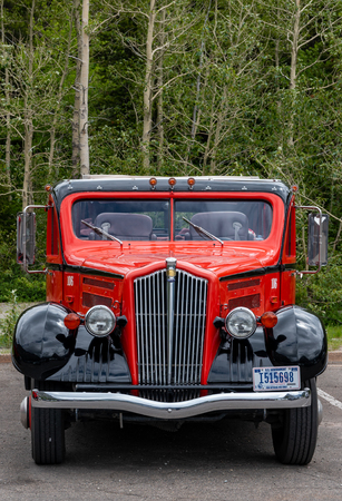 Many Glacier, United States: June 29, 2018: Parked Red Jammer From Front Redactioneel