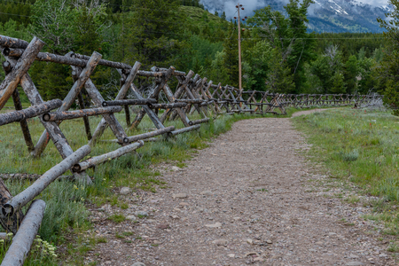 Wide Dirt Trail Along Wooden Fence in Tetons Stock fotó