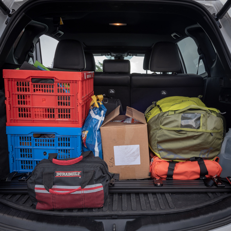 June 10, 2018: Conceptual Editorial of Back of Car Packed for Road Trip with camping gear and snacks