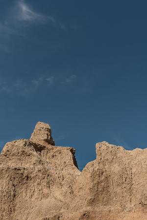Dry Hoodoo and Blue Sky in South Dakota Badlands Stock Photo