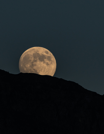 Full Moon Rises Above Glacier National Park. just after dusk Stock Photo