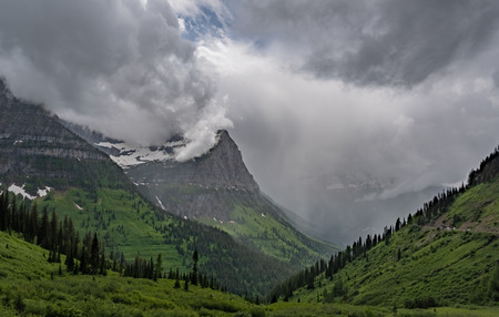 Rain In The Valley Below Mt Oberlin from Logan Pass Stock Photo