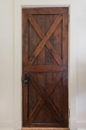 Rustic Wooden Door on interior hallway of historic lodge
