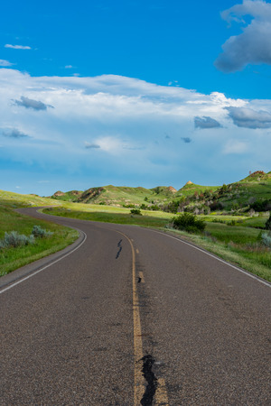 Curving Road On The Prarie through Theodore Roosevelt National Park