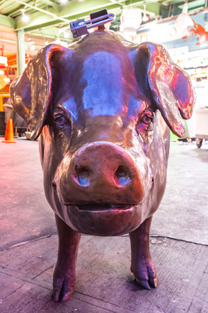 October 6, 2018: Seattle, United States: Face of Bronze Pig in Pkes Place Market