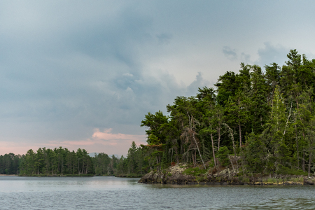 Forest and Rocks At The Edge of Rainy Lake in northern Minnesota Stock Photo