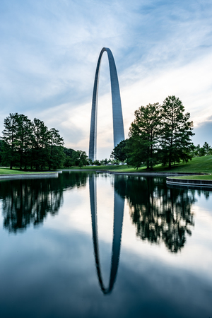 Saint Louis, United States: June 12, 2018: Gateway Arch Reflects in Pond in morning light