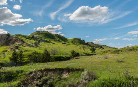 Green Hills On Prairie in summer with blue sky