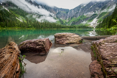 Rocks At The Edge of Avalanche Lake in Glacier National Park