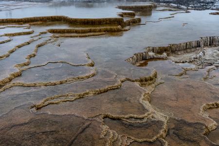 Layers of Volcanic Rock Hold in Water in Yellowstone Reklamní fotografie - 120427403