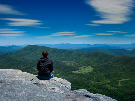 Hiker Looking out over mountain range