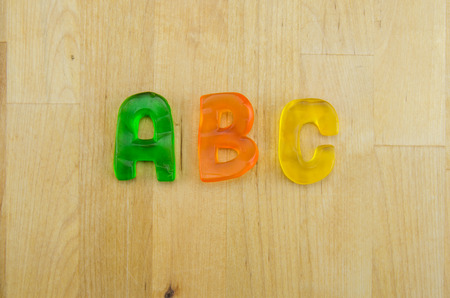 Multi colored gummy letters spell A B C