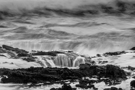 Black and White of Thors Well with moody waves