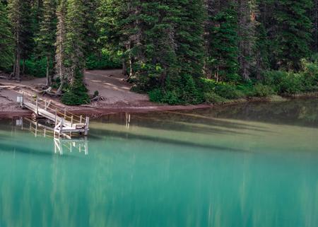 Empty Boat Dock on Lake Josephine in Montana wilderness