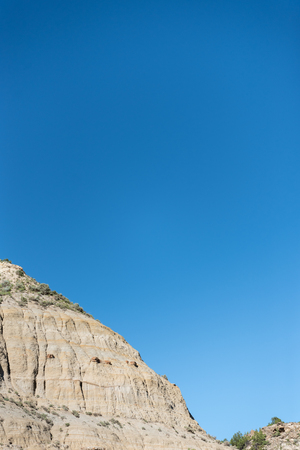 Edge of Hoodoo and Blue Sky in North Dakota badlands