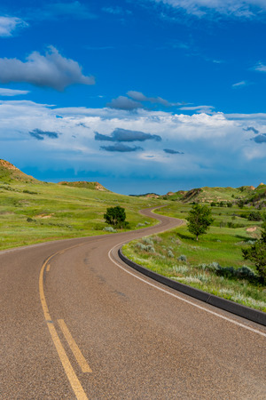 Curving Road Disappears Into The Hills in North Dakota