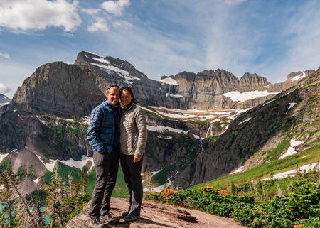Couple Pose for Photo at overlook to Grinnell Lake Banco de Imagens