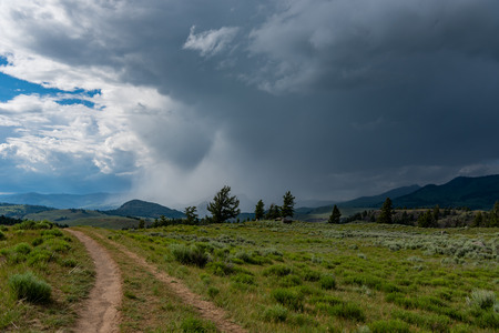 Double Trail Trail Heading Into Stormy Sky in Early Summer