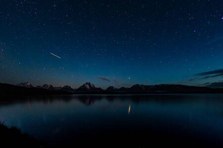 Airplane Light and Stars over Jackson Lake and Grand Teton Range