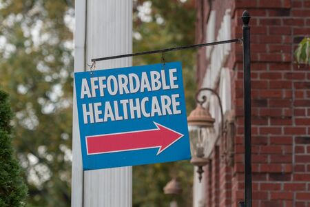 Affordable Healthcare Sign hangs outside a building during a time when government officials are trying to improve the system