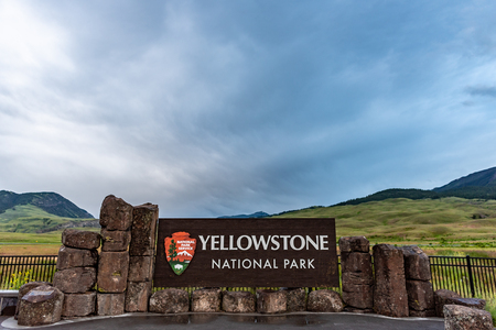 Gardiner, United States: June 23, 2018: Smooth Clouds Over Yellowstone Sign