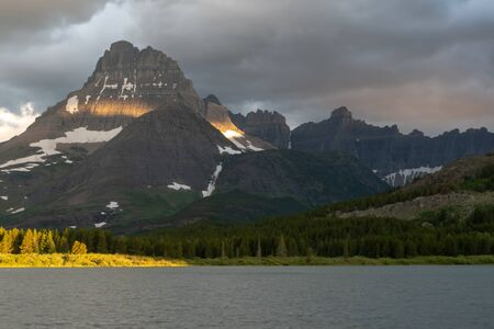 Sun Shines on the Peak of Mount Wilbur in Glacier National Park