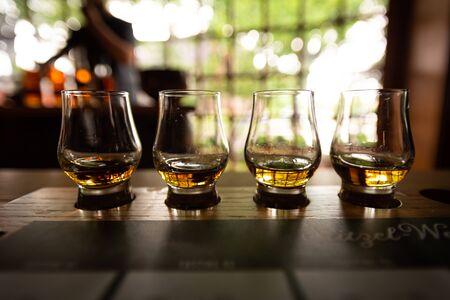 Bourbon Flight with selective focus on four samples Standard-Bild - 125590046