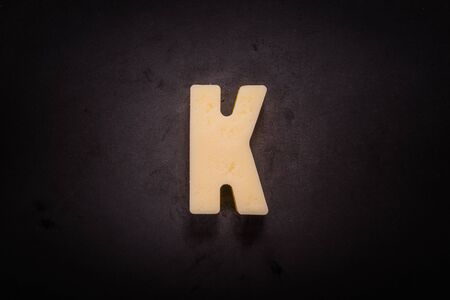Butter Forms K on cast iron skillet background