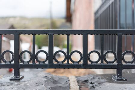 Wrought Iron Detail on Outdoor Railing with Rain Drops Standard-Bild - 126501706