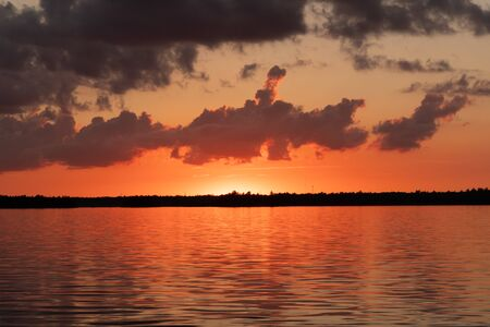 Pink and Orange Skies Light at Sunset Over Rainy Lake