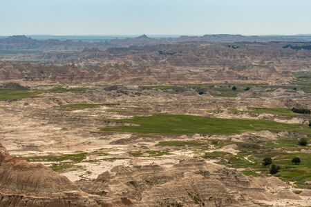 Badlands and Fields Stretch Out Over Landscape