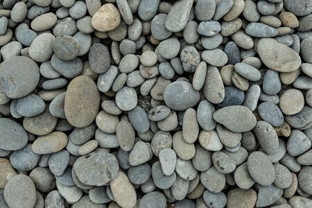 Background Image of Smooth Ocean Rocks on Rocky Shore
