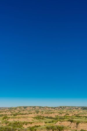 Blue Sky and North Dakota Badlands on clear summer day