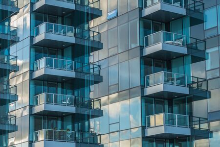 Glass Balconies Reflect Morning Light on modern skyscraper 版權商用圖片