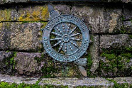 Daughters of The American Revolution Sign on stone wall